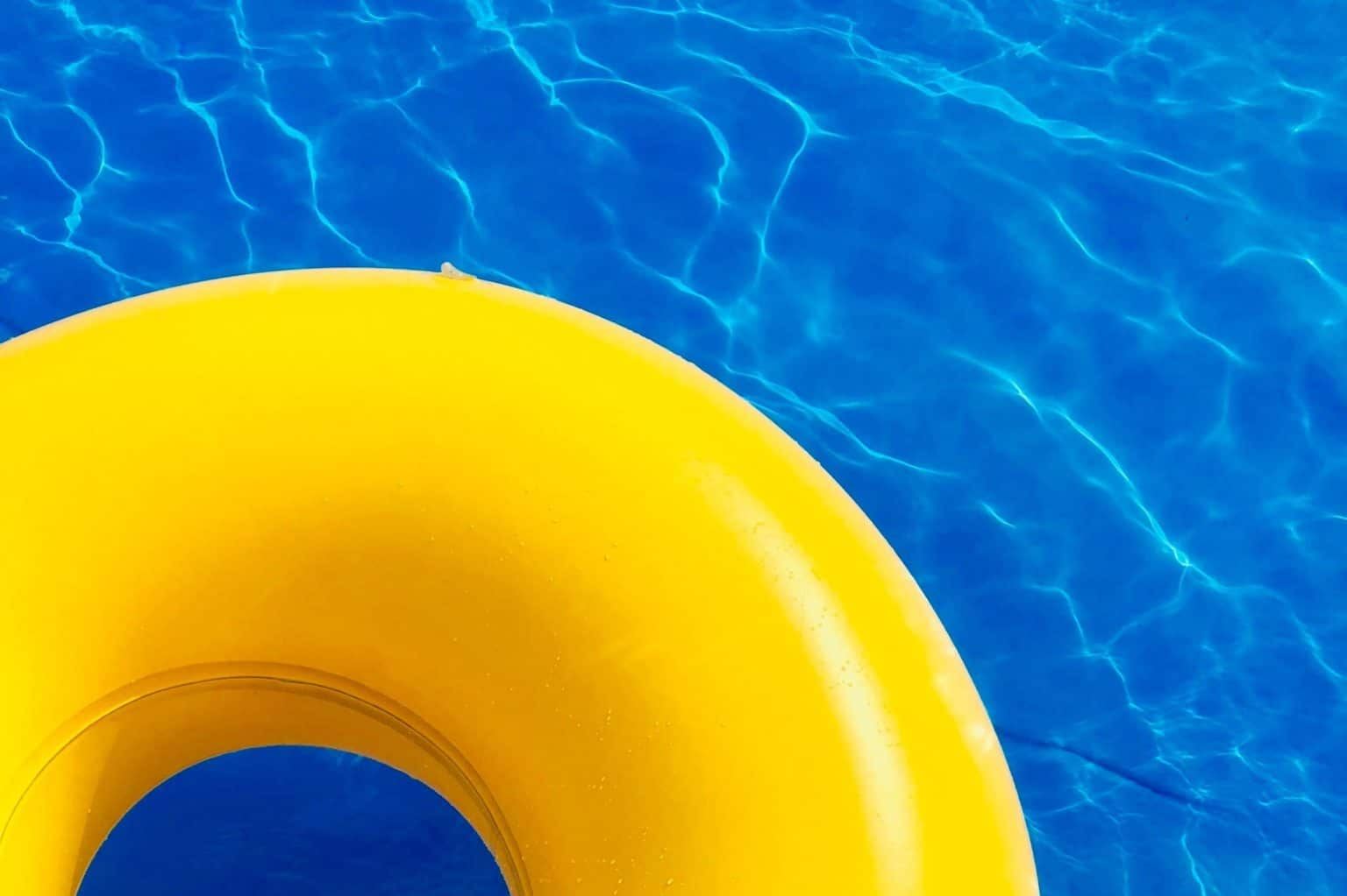 yellow inner tube in pool - pool inspections