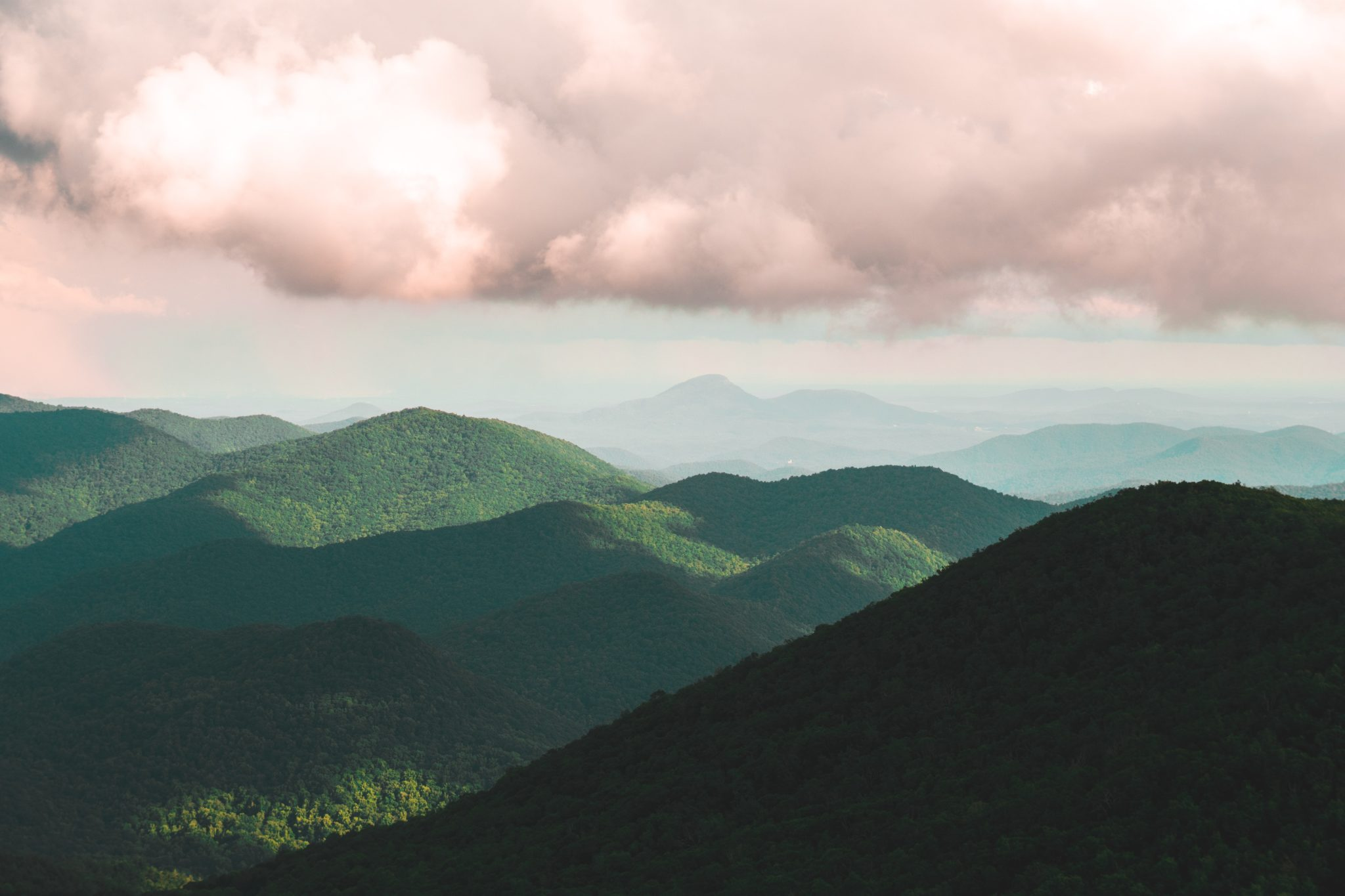 View of green mountains and pink sky in Brasstown Bald, Georgia, near the GAHI 30th Anniversary Conference